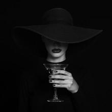 Luxury Woman In A Black Hat Wi...