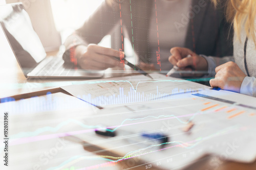 business working with woman and friend with laptop and paperwork with color tone Wallpaper Mural