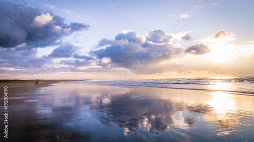 Photo  Walking along the beach during sunset in IJmuiden the Netherlands,