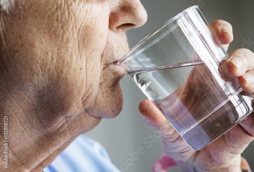 Side view of elderly woman drinking water Canvas Print