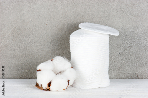 Wadded pads and cotton flower on the table Poster