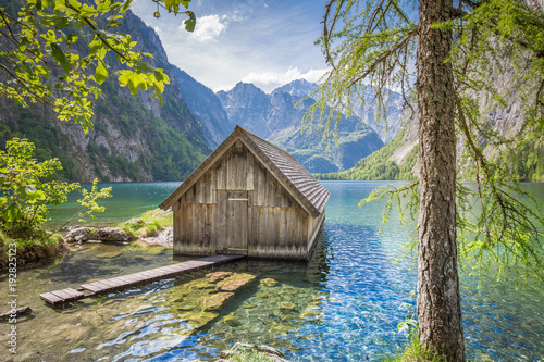 Lake Obersee with boat house in summer, Bavaria, Germany