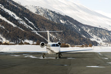 A Private Jet Is Ready To Take Off In The Airport Of St Moritz Switzerland In Winter