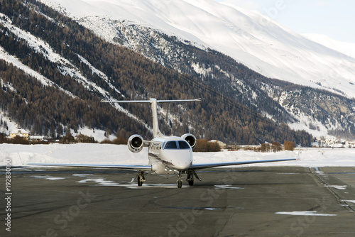 Fényképezés A private jet is ready to take off in the airport of St Moritz Switzerland in wi