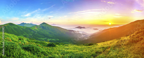 Foto auf Gartenposter Hugel Beautiful sunrise in mountains with white fog below panorama