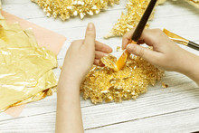 Gilding Process. Female Hands With A Brush. Gold Leaf