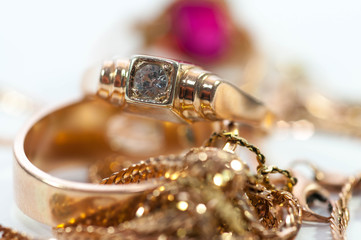Gold jewelry  with gems , c...