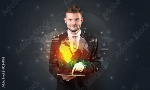 Fotografia, Obraz  Spectacled businessman with tablet and apps above