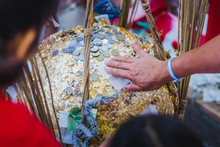 "Thailand Tradition, An Inauguration Ceremony Called ""FANG LUUK NIMIT"" Is Done To Consecrate A Temple. Some Sacred Marker Spheres ""LUUK NIMIT"" Need To Be Buried In The Temple Compound."