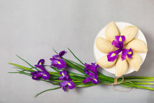 Novruz Traditional Pastry Shekerbura In Round White Plate Cake Stand With Bouquet Purple Lilac Flowers Fleur De Lis On Grey Background, Spring Celebration In Azerbaijan, Greeting Card Copy Space