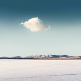 Cloud over a frozen lake. Beautiful winter landscape - 192870967