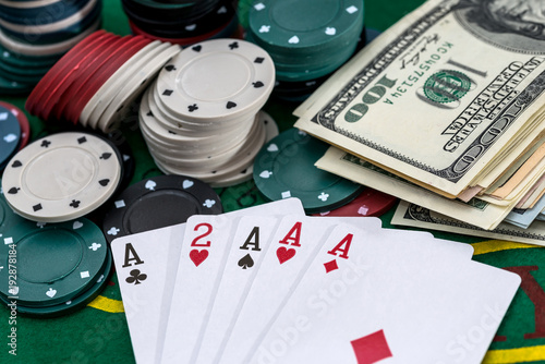 Poker set with money close up on green плакат
