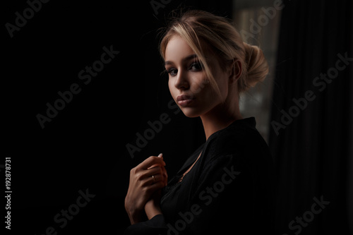 1e89dccd0 Beautiful young stylish girl with a haircut in black clothes in a ...