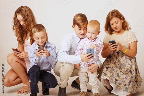 Children Using Electronic Gadgets As A Symbol Of Dependence On