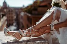 Caucasian Bride Fastening Her Silver Wedding Shoes Outdoor
