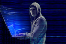 Hacker In Mask With Laptop On ...