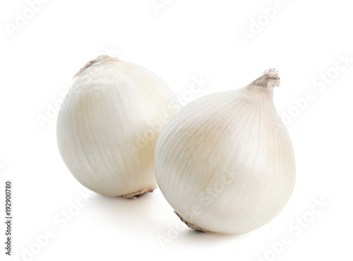 Fresh ripe onions on white background