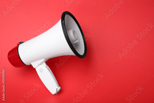 Photo  Electronic megaphone on color background