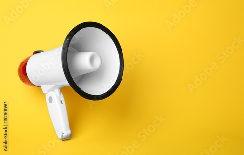 фотографія  Electronic megaphone on color background
