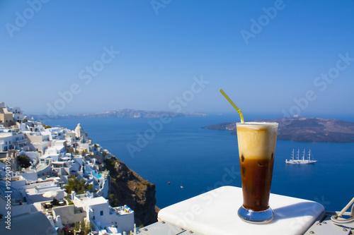 Staande foto Eiland Greece Santorini island in Cyclades, coffee espresso freddo with wide sea of caldera in greek caffe