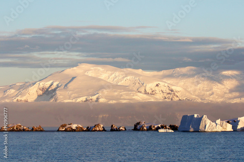 Foto op Canvas Antarctica Antarctica on a Sunny day- Antarctic Peninsula - Sunset light and blue sky
