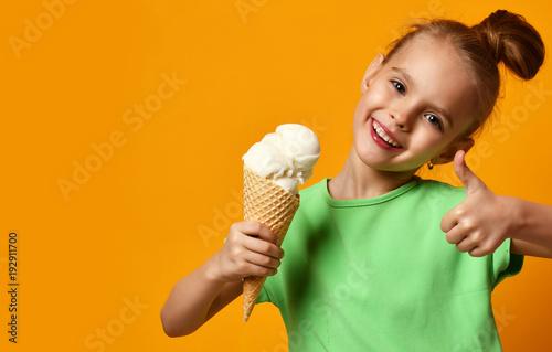 Fotografie, Obraz  Pretty baby girl kid eating licking vanilla ice cream in waffles cone