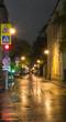 quiet city street at rainy night. background