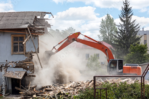 excavator working at the demolition of an old residential building Wallpaper Mural