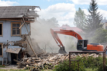Bulldozer Removes Debris From Demolition Old Building On Construction Site