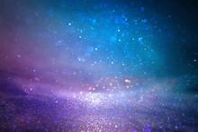 Glitter Vintage Lights Background. Purple, Blue And Pink. De Focused.