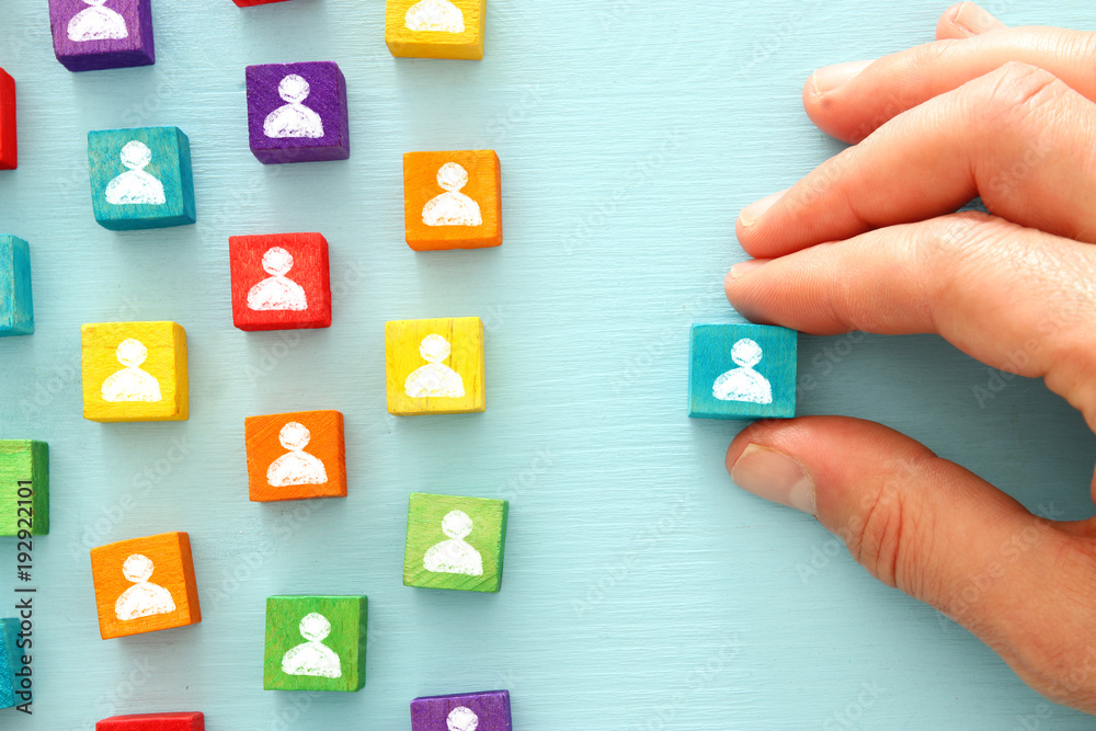 Photo  image of colorful blocks with people icons over wooden table ,human resources and management concept