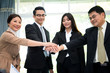 Team Business Partners shaking hands together to Greeting Start up new project