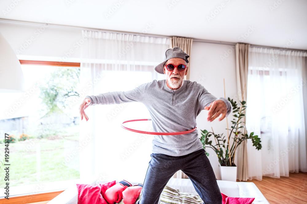 Fototapety, obrazy: Senior man having fun at home.