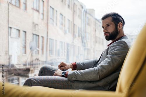 Fototapety, obrazy: stylish pensive man sitting on yellow sofa at window