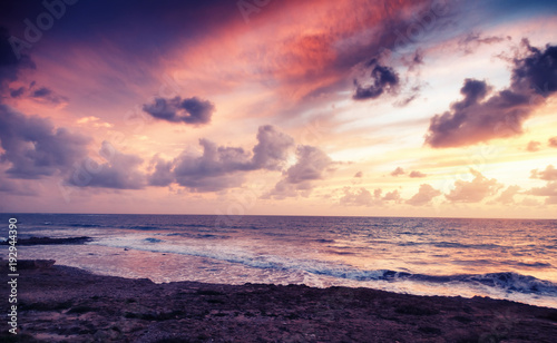Foto op Plexiglas Zee zonsondergang fantastic stunning colorful landscape, sunset on the shore of the blue sea, the coast of Cyprus, the neighborhood of Paphos