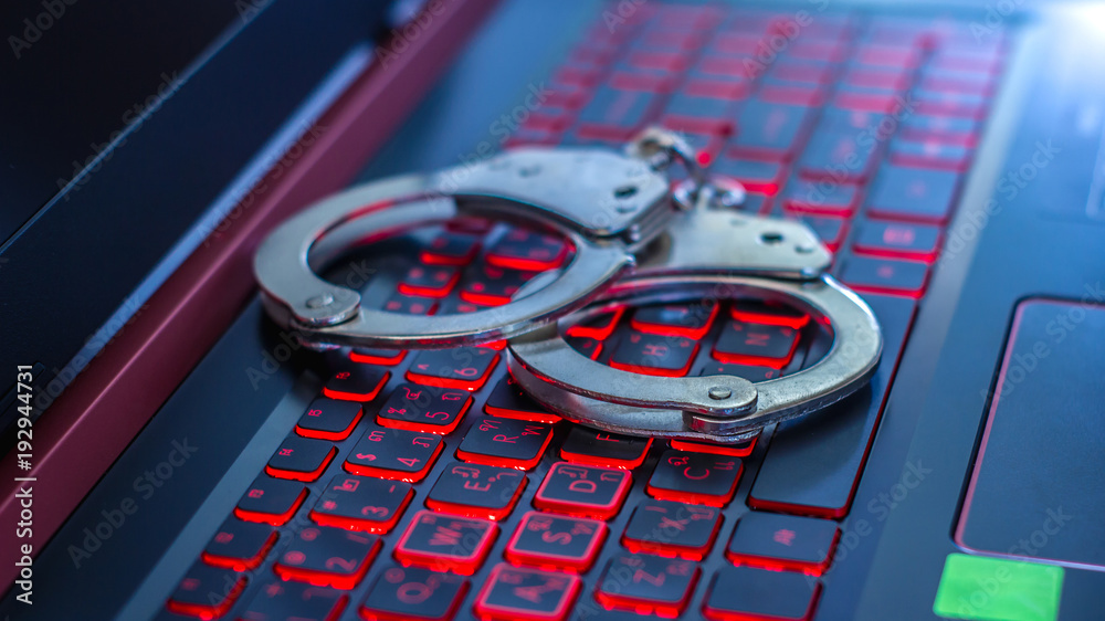 Fototapeta Handcuffs on the laptop,cyber crime concept
