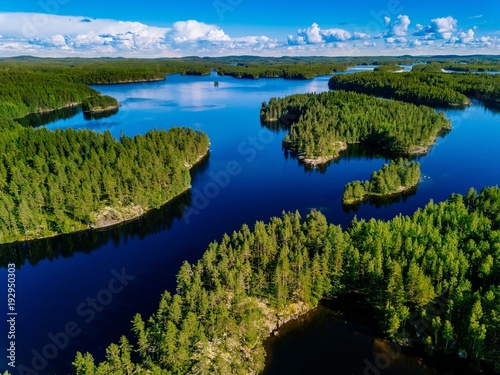 Poster Lac / Etang Aerial view of blue lakes and green forests on a sunny summer day in Finland.