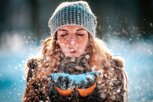 Winter Woman Blowing Snow Outd...