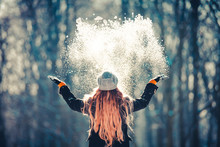 Young Girl Throwing Snow In Th...