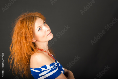 Fotografija  Young woman with red curly hair