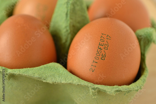 Fotografía  Close-up of eggs with expiration date