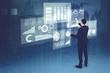 Caucasian businessman working on futuristic business charts