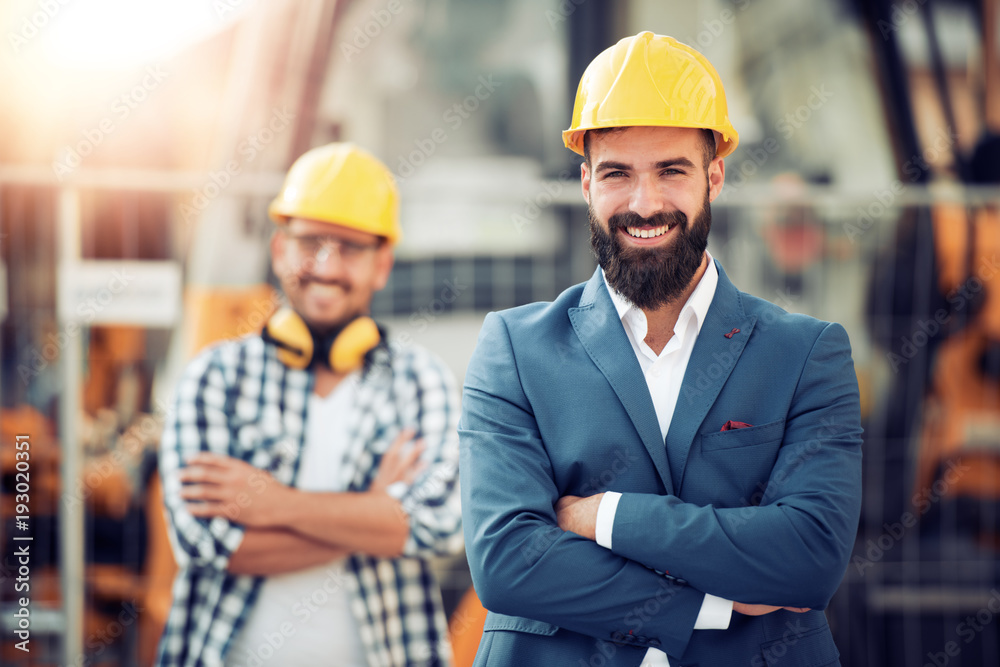 Fototapety, obrazy: Construction specialist and worker outdoors.
