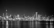 Big city skyline on water at night