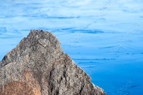 Foto op Aluminium Blauw Stone in the thin ice