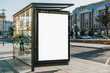 canvas print picture - Vertical blank white billboard at bus stop on city street. In the background buildings and road. Mock up. Poster on street next to roadway. Sunny summer day.