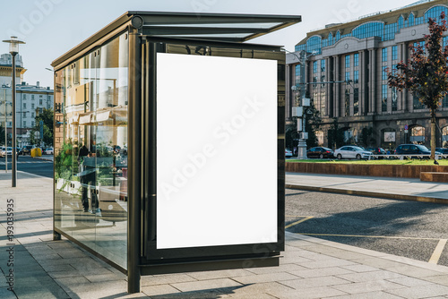 canvas print motiv - foxyburrow : Vertical blank white billboard at bus stop on city street. In the background buildings and road. Mock up. Poster on street next to roadway. Sunny summer day.