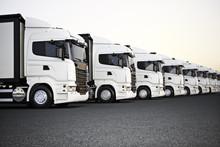 Fleet Of White Commercial Tran...