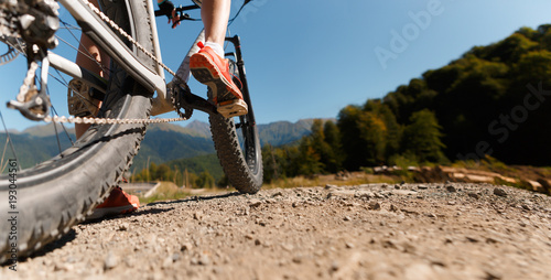 Photo bottom of woman on bicycle Canvas Print