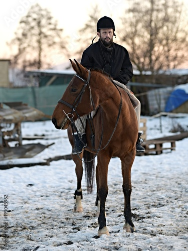 Fotografija Down syndrome man with horse. Hippotherapy